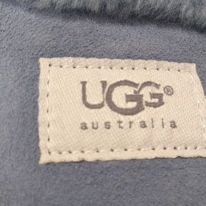 An ugg purse with chain also muff